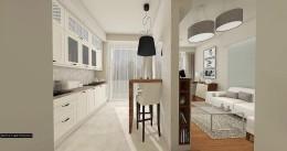 Śmietankowo-miętowa aranżacja salonu z kuchnią