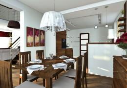 Salon z antresolą oraz jadalnia w domu jednorodzinnym.
