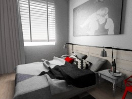 sypialnia w mieszkaniu z czerwonymi akcentami