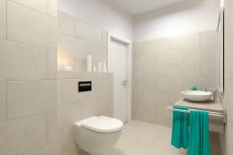 Łazienki i toaleta w jasnym apartamencie